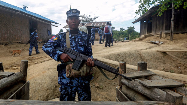 A Myanmar border guard policeman guards a police station in Buthidaung township, western Myanmar's Rakhine state, Jan. 7, 2019.