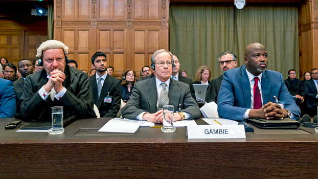 Gambian Justice Minister Abubacarr Marie Tambadou (R) sits with British lawyer Philippe Sands (L) and US lawyer Paul Reichler (C) at the start of a three-day hearing on the Rohingya genocide case against Myanmar before the UN International Court of Justice in The Hague, the Netherlands, Dec. 10, 2019.