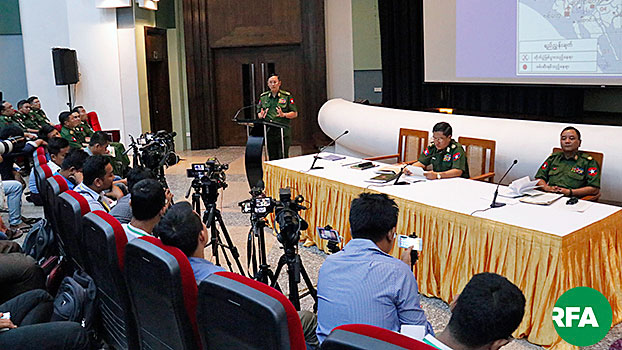 Myanmar military spokesmen address the media at a press conference in Myanmar's capital Naypyidaw, accusing some news agencies of exaggerating reports and twisting facts in their stories about the armed services, June 22, 2019.