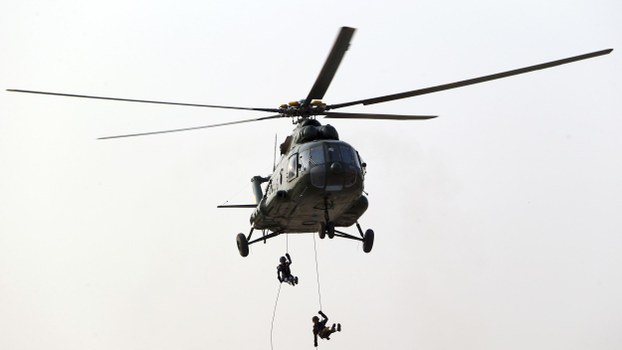 Myanmar soldiers rope down from a helicopter on Myanmar's 73rd Armed Forces Day in the capital Naypyidaw, March 27, 2018.