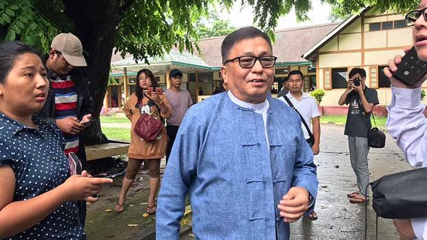 Rev. Hkalam Samson (C) of the Kachin Baptist Convention leaves Myitkyina Township Court in Myitkyina, capital of northern Myanmar's Kachin state, Sept. 9, 2019.