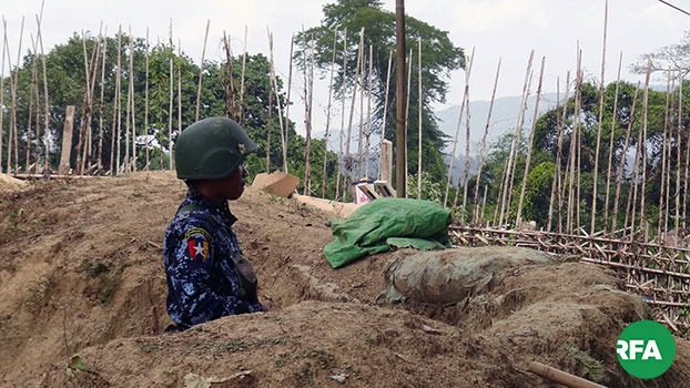 A border police officer patrols an area of western Myanmar's Rakhine state in an undated photo.