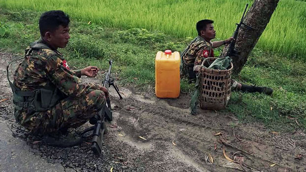 Myanmar soldiers man  a checkpoint on a rural road near Maungdaw township in western Myanmar's Rakhine state, Aug. 30, 2017.