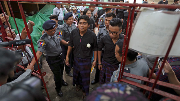 Zayar Lwin, (C), leader of the Peacock Generation performance group, and his colleague Paing Phyo Min (R) leave court after their trial and sentencing in Mayangone township of Myanmar's Yangon region, Oct. 30, 2019.