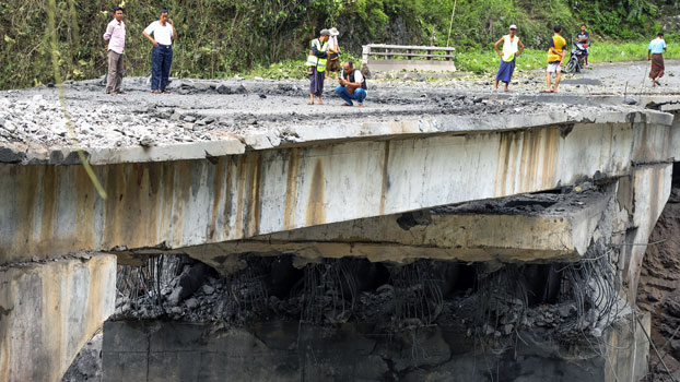 People inspect the Gote Twin Bridge damaged during an attack by an alliance of three ethnic armies in Nawngkhio township, Myanmar's northern Shan state, Aug. 15, 2019.