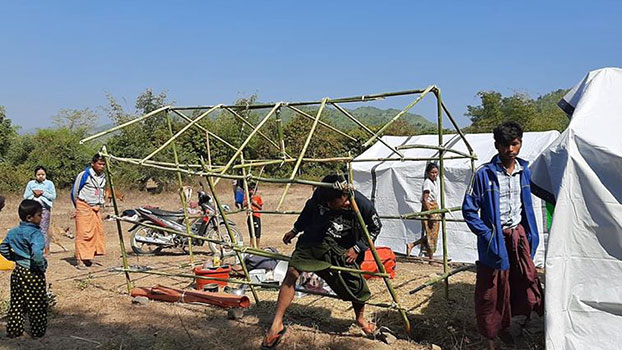 A man sets up a tent at an IDP camp in Sanyin village, Myebon township, western Myanmar's Rakhine state in an undated photo. Myanmar soldiers destroyed the camp on Jan. 25, 2020.