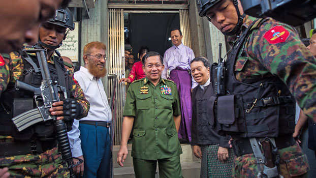 Myanmar military commander-in-chief Senior General Min Aung Hlaing (C) leaves the Muslim Free Hospital and Medical Relief Society in Yangon following a visit, Sept. 17, 2019.