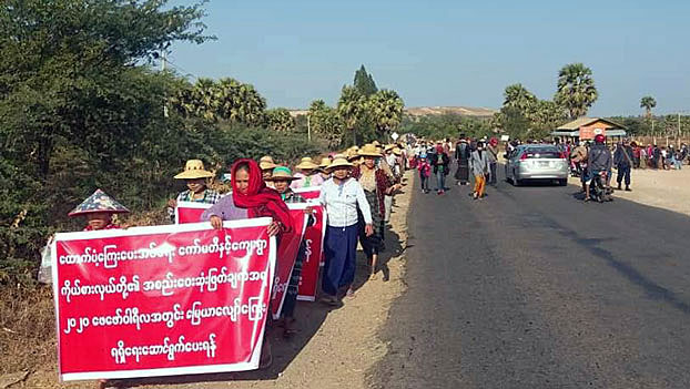 Villagers march along a road during a protest against a Chinese-backed copper mining company in Salingyi township, northwestern Myanmar's Sagaing region, Dec. 30, 2019.
