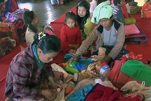 Myanmar villagers who fled fighting between government troops and Ta'ang National Liberation Army soldiers take shelter in a school in Kyaukme, Myanmar's northern Shan state, Dec. 29, 2016.