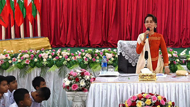 Myanmar State Counselor Aung San Suu Kyi answers questions from local people during a visit to Tharrawaddy township in south-central Myanmar's Bago region, March 14, 2019.