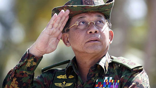 Myanmar military chief Senior General Min Aung Hlaing salutes during military exercises in Myanmar's Ayeyarwaddy delta region, Feb. 3, 2018.