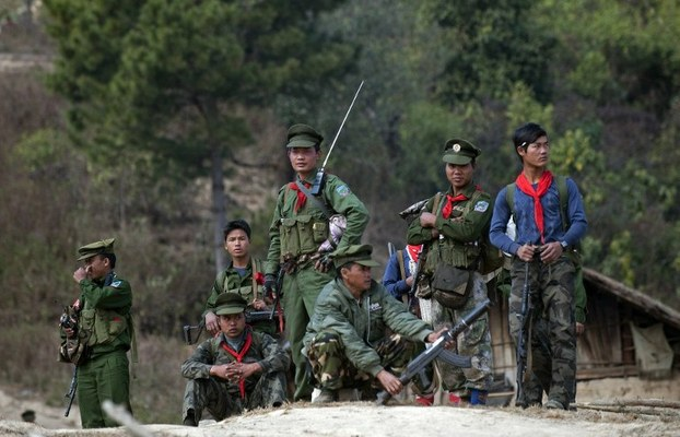 Ta'ang National Liberation Army soldiers stand guard outside a village in Mantong township in Shan state, Jan. 16, 2014.