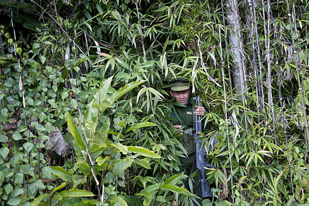 A soldier from the Ta'ang National Liberation Army emerges from a forest in Mantong township in Myanmar's northern Shan state, Jan. 16, 2014.