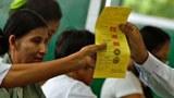 myanmar-election-official-ballots-mandalay-nov8-2015-teaser.jpg