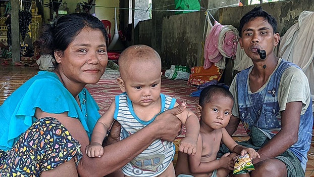 A family from Panmyaung village in Minbya township, western Myanmar's Rakhine state, seeks shelter in a monastery after fleeing their home amid armed conflict, Aug. 27, 2019.