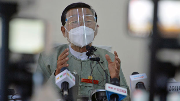 Myint Naing, a member of and spokesman for Myanmar's Union Election Commission, speaks to reporters during a press conference in Naypyidaw, Nov. 11, 2020.