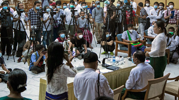Aye Min Moe (R), the spokeswoman for Myanmar's Union Solidarity and Development Party in Yangon region, addresses reporters during a press conference in Yangon, Nov. 11, 2020.