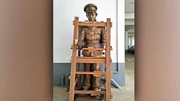 A stature of Myanmar's independence hero General Aung San is supported by a wooden frame as it stands in a lot in Hakha, capital of western Myanmar's Chin state, October 2018.