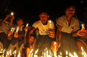 Demonstrators hold a candlelight protest at Sule Paya Pagoda in Rangoon, May 23, 2012.