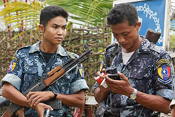 Armed border police stand guard in Maungdaw township, western Myanmar's Rakhine state, Oct. 10, 2016.