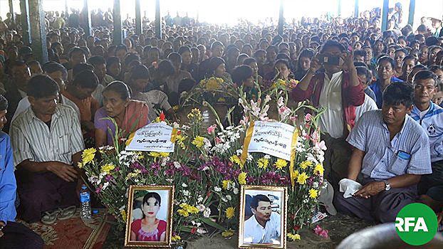 A funeral is held for village administrator Nyan Thein and a female resident who were killed by gunfire from Myanmar soldiers in Satetaya village, Minbya township, western Myanmar's Rakhine state, December 2019.