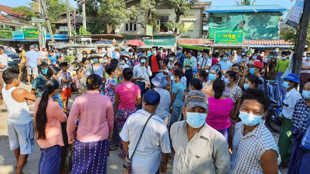 Protesters demand action from local administrative officials over what they say is the  mismanagement of COVID-19 relief funds for working-class families, in Mingaladon township, lower Myanmar's Yangon region, Nov. 14, 2020.