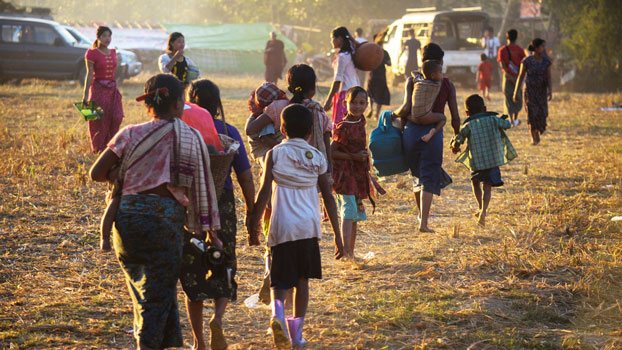 Civilians displaced by fighting between ethnic Rakhine rebels and Myanmar's army arrive at a temporary camp in Kyauktaw township, western Myanmar's Rakhine state, Jan. 4, 2019.