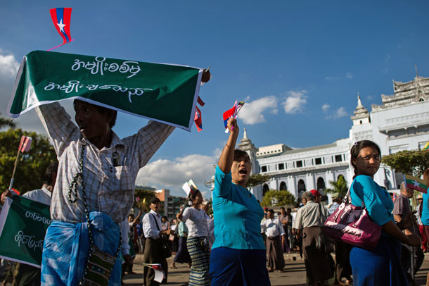 Myanmar demonstrators show their support for Myanmar military personnel engaged in fighting in the country's northern Kachin state, in downtown Yangon, Dec. 18, 2016.