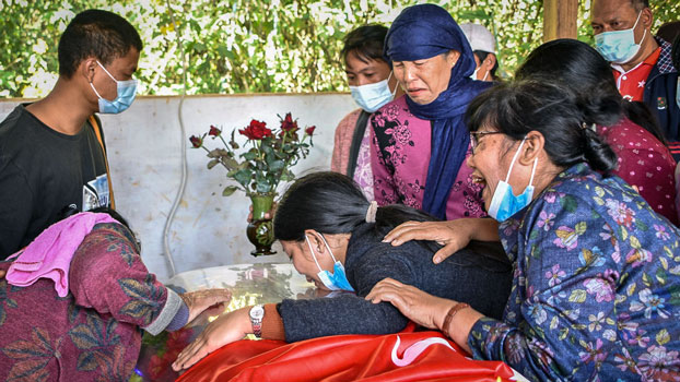 Friends and relatives mourn the death of lawmaker-elect Htike Zaw, a National League for Democracy politician gunned down by unknown assailants, at his funeral in Kyaukme township, Myanmar's northern Shan state, Nov. 22, 2020.