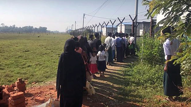 Rohingya refugees wait in line to return to Myanmar's Rakhine state in an undated photo.