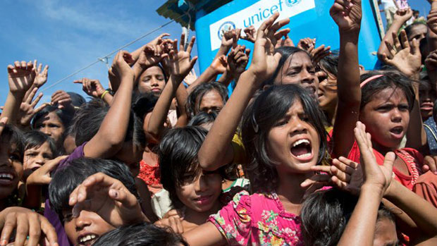 Rohingya children shout slogans at the Unchiprang refugee camp near Cox's Bazar, Bangladesh, Nov. 15, 2018.