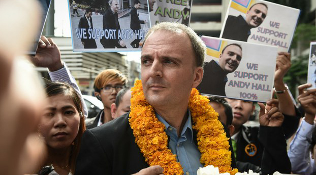 British labor activist Andy Hall speaks to reporters outside the Bangkok South Criminal Court in a Sept. 20, 2016 photo.