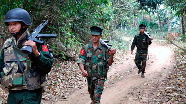 Kachin Independence Army soldiers walk along a jungle path in an area controlled by the rebel force in northern Myanmar's Kachin state, March 17, 2018.