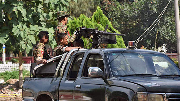 Myanmar military soldiers patrol the streets of Hsenwi town in Lashio district, northern Shan state, following an ambush on an army convoy by an ethnic armed group, Oct. 9, 2019.