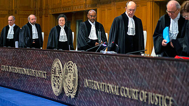 Presiding judge Abdulqawi Ahmed Yusuf (C) and other judges take their seats at the International Court of Justice in The Hague, the Netherlands, Jan. 23, 2020.