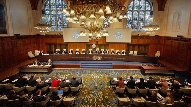 Judges of the International Court of Justice read a judgment at a hearing in The Hague, the Netherlands, Nov. 8, 2019.