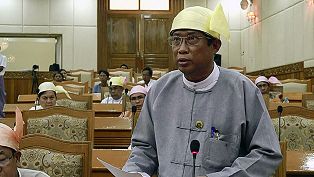 Kyaw Aye Thein, Rakhine state's minister of finance, revenue, planning, and economy, speaks during a session of the Rakhine state parliament in Sittwe, western MYanmar's Rakhine state, Sept. 25, 2018.