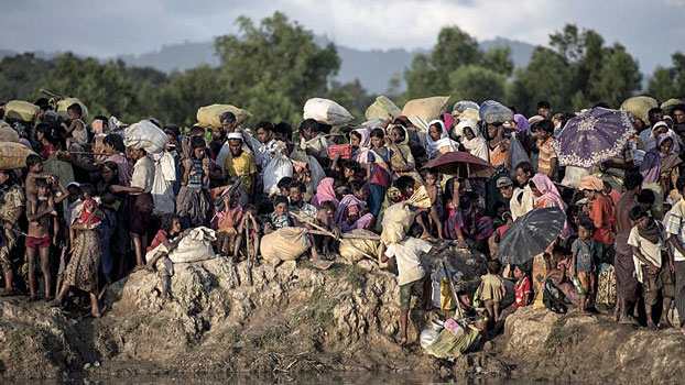 Rohingya refugees fleeing from Myanmar arrive at the Naf River in Whaikyang on the Bangladesh border. Oct. 10, 2017.