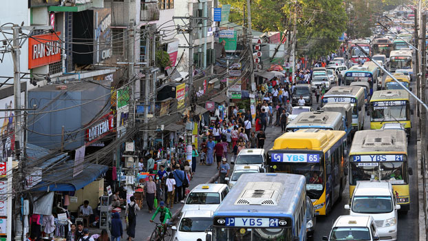 Public buses and other vehicles clog a road in Myanmar's commercial capital Yangon, March 17, 2020.