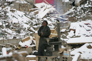 A Tibetan woman stands in the rubble of destroyed homes in Gyegu, in China's Qinghai province, April 22, 2010.