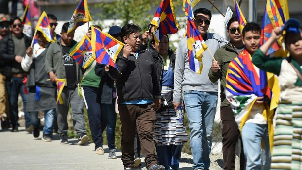 Tibetans living in exile in India march during the 60th anniversary of the Tibetan Uprising Day that commemorates the 1959 Tibetan uprising, in McLeod Ganj, March 10, 2019.