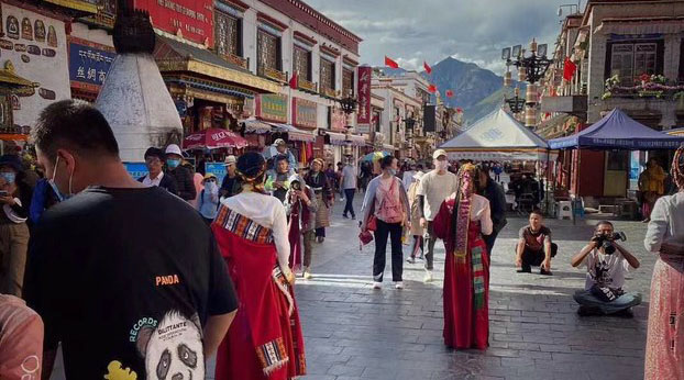 Chinese tourists are shown walking in Lhasa's central Barkhor area in a 2020 photo.