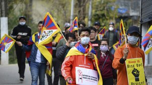 Tibetans living in exile wear protective masks in protest march from McLeod Ganj to Dharamshala to mark the 61st anniversary of the 1959 Tibetan Uprising, in McLeod Ganj, March 10, 2020.