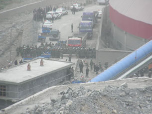 In a photo submitted by a local resident, police confront Tibetans on a road in Yarshul village, May 15, 2010.
