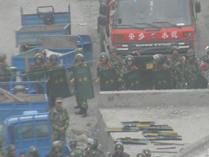In a photo submitted by a local resident, police confront Tibetans on a road in Yarshul village, May 15, 2010. Credit: Local resident