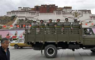 Chinese riot policemen in front of the Potala palace in Lhasa on June 20, 2008.