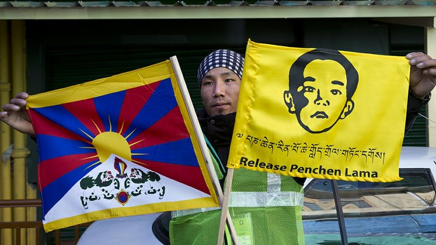 A member of the Tibetan Youth Congress poses for a photograph before embarking on a motorcycle rally to create awareness about the Panchen Lama in Dharmsala, India, April 23, 2019.
