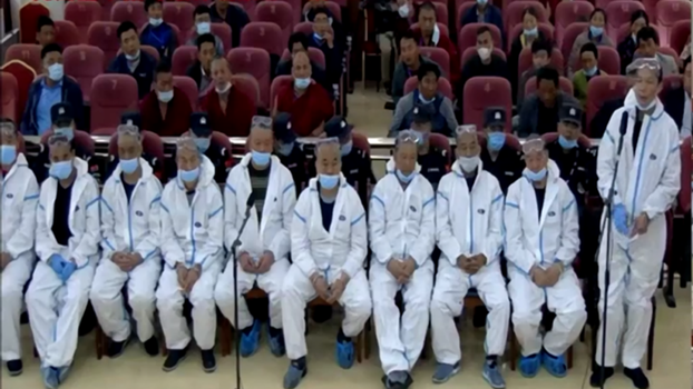 Tibetan land protesters are shown at their trial in a court in Gansu's Sangchu county, June 29, 2020.