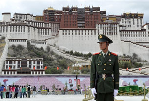 A Chinese policeman stands guard in front of the Potala Palace in Lhasa, June 20, 2008.
