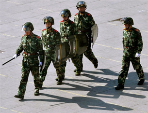 Chinese soldiers patrol a street in the Kardze Tibetan Autonomous Prefecture, March 23, 2008.